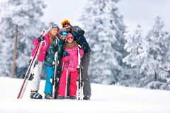 Family together skiing on mountain. Family together skiing on snowy mountain and looking something in distance Stock Photography