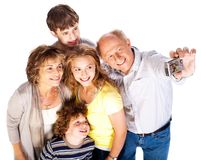 Family together taking self-portrait Stock Photography