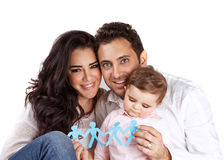 Family togetherness concept. Young arabic family isolated on white background, holding in hands bonding paper people figure, safety and security, human royalty free stock photos