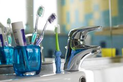Family toothbrushes in bathroom royalty free stock photos