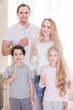 Family with toothbrushes Stock Photography