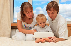 Family with touch pad at home Royalty Free Stock Images
