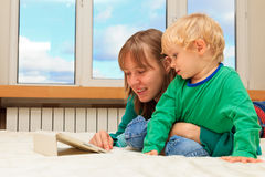 Family with touch pad at home Royalty Free Stock Image