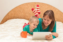 Family with touch pad at home Stock Photo