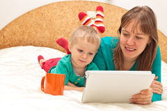Family with touch pad at home Stock Photography