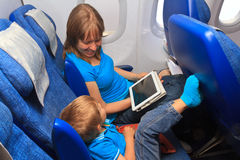 Family with touch pad in plane. Mother and son with touch pad in plane, family travel Stock Photography