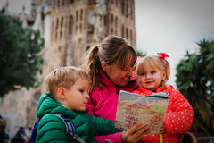 Family tourism - mother with kids travel in Barcelona Royalty Free Stock Photos
