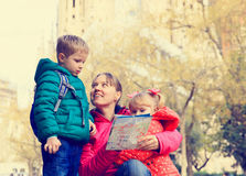Family tourism - mother with kids travel in european city Royalty Free Stock Images