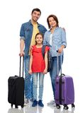 Happy family with travel bags. Family, tourism and vacation concept - happy smiling mother, father and little daughter with travel bags over white background stock images