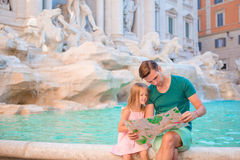 Family with touristic map near Fontana di Trevi. Father and adorable girl on italian holiday in Europe. Family with touristic map near Fontana di Trevi Royalty Free Stock Photos