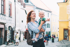 Family of Tourists in Cesky Krumlov, Czech Republic, Europe. Family of Tourists on medieval street in old Town of Cesky Krumlov, Czech Republic. Springtime or Royalty Free Stock Photo