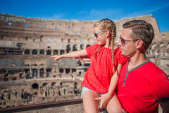 Family tourists in Coliseum, Rome, Italy. Family portrait at famous places in Europe Royalty Free Stock Photo