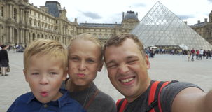 Family of tourists shooting themselves by the Louvre stock video footage