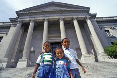 Family of tourists on the steps of the Benjamin Franklin Institute, Philadelphia, PA Royalty Free Stock Image