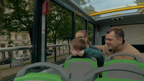 Family of tourists traveling by double-decker bus in Vienna stock video