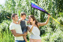 Family with toy kite at park Stock Images