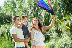 Family with toy kite at park Royalty Free Stock Image