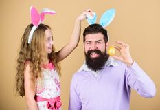 Family tradition concept. Dad and daughter wear bunny ears. Father and child celebrate easter. Spring holiday. Easter. Spirit. Easter activities for whole stock images