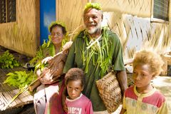 Family, traditional costumed, nature material, Solomon Islands, South Pacific Ocean Royalty Free Stock Images