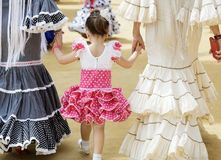 Family in traditional dress taking a walk and enjoying at the Seville`s April Fair. Family in traditional dress taking a walk and enjoying at the Seville`s stock photos