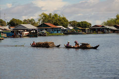 Family transport fire wood by small boat Tonle Sap Lake Cambodia Stock Photography