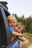Family travel. Baby with mother looking through car window Royalty Free Stock Photo