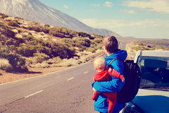 Family travel by car-father with baby on road in mountains. Family travel by car- father with little baby on road in mountains Royalty Free Stock Images