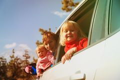 Family travel by car- father with kids driving in mountains. Family travel by car- happy father with kids driving in mountains stock images