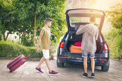 Family travel with car. And suitcases Royalty Free Stock Photography