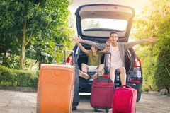Family travel with car. And suitcases Stock Photo
