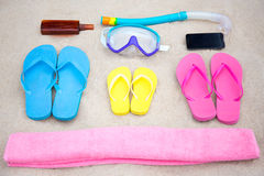 Family travel concept - summer beach accessories on the sand Stock Image