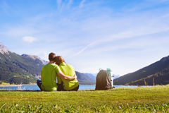 Family travel, couple of hikers in mountains Royalty Free Stock Image