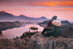 Family travel Europe. Bled Lake, Slovenia. Family travel Slovenia, Europe. Mother with son looking on sunset on Bled Lake. Winter landscape. Top view on Island royalty free stock photography