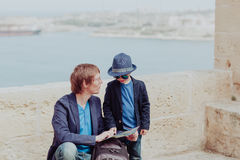 Family travel in Europe- father and little son looking at map Royalty Free Stock Image