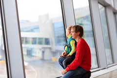 Family travel- father and son in the airport Royalty Free Stock Image