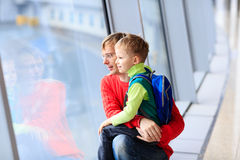Family travel- father and son in the airport Stock Photo