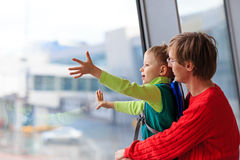 Family travel- father and son in the airport Royalty Free Stock Photo