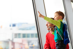 Family travel- father and son in the airport Stock Image