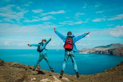 Family travel - happy father and son enjoy hiking in nature stock images