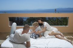 Family travel with kid on mothers or fathers day. Mother and father with son on balcony. Summer vacation of happy family. Love and trust as family values Royalty Free Stock Photography