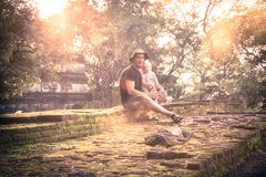 Family travel lifestyle portrait of man traveler with child daughter resting together on ruins at sunset during vacation concept t stock photos