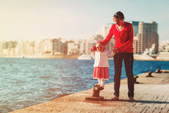 Family travel - mother and little daughter in port. Family travel - happy mother and little daughter in port stock photo