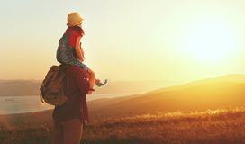 Family travel and tourism father and daughter on top of mounta. Family travel and tourism father and daughter with backpacks on top of mountain at sunset stock image