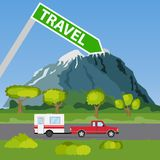 Family traveler truck summer trip concept. A pickup truck with a trailer rides along the road in the mountains and forest Royalty Free Stock Images