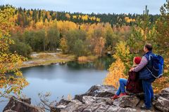Family travelers looking at a mountain lake in Marble Canyon. Royalty Free Stock Photo