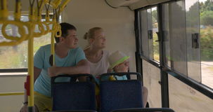 Family traveling by bus in the countryside stock footage