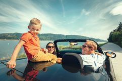 Family traveling by cabriolet car royalty free stock image