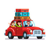 Family traveling by car with luggage bags on roof. Happy family traveling by car with a luggage bags on the roof. Mother, father and son on vacation road trip Royalty Free Stock Images
