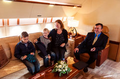 Family traveling by commercial air jet Royalty Free Stock Photos
