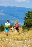 Family traveling through the mountains Stock Photo